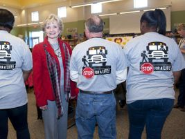 North Carolina State Superintendent Dr. June Atkinson stands with Wake County school bus drivers...