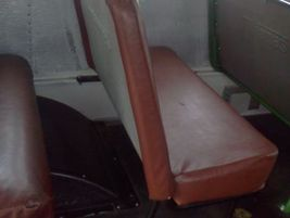 A 1976 model. The seat back is 21 inches tall and 3.5 inches thick.