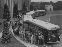 In this circa-1940s shot, students file onto Lower Merion School District buses at Bala Cynwyd...