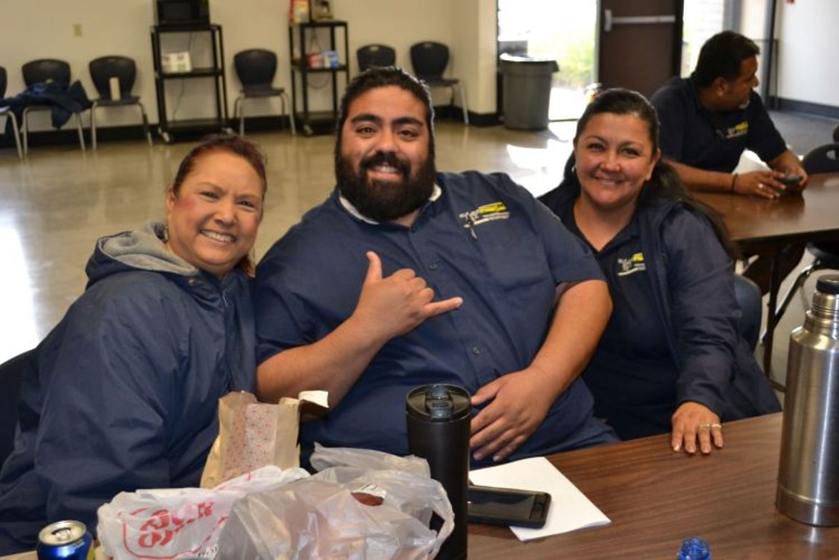 School bus drivers eat lunch and share a few laughs in the lounge.
