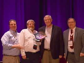 During the NAPT awards ceremony, Ken Hedgecock (second from right), the current vice president...