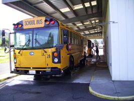 The facility includes a bus wash bay.