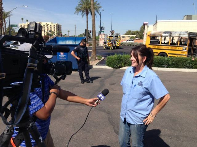 The Mesa Fire Department credited school bus driver Cynthia Wells — seen here being interviewed...