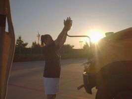 Denise Poynor, a school bus driver at Frisco (Texas) Independent School District, helps another...
