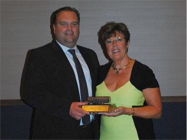 Markus Videnieks has left ASBC after serving as coordinator since 2012. He is seen here presenting ASBC's School Bus Champion Award to Magda Dimmendaal last year.