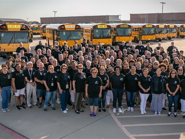 The team also kicked off the school year with a cheerful group photo in front of the district's buses. Photo courtesy Allen ISD