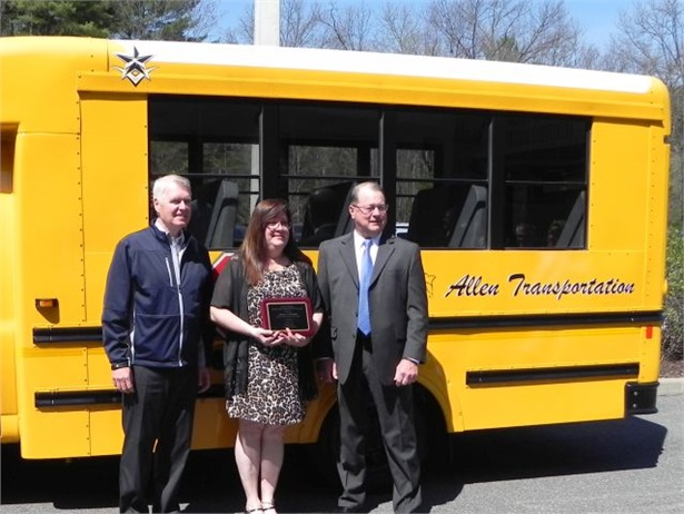 Andrea Whittaker, Ulster County's School Bus Driver of the Year, is seen here with Deputy County Executive Robert Sudlow (right) and Gary Mulligan, former owner of Arthur F. Mulligan Inc.