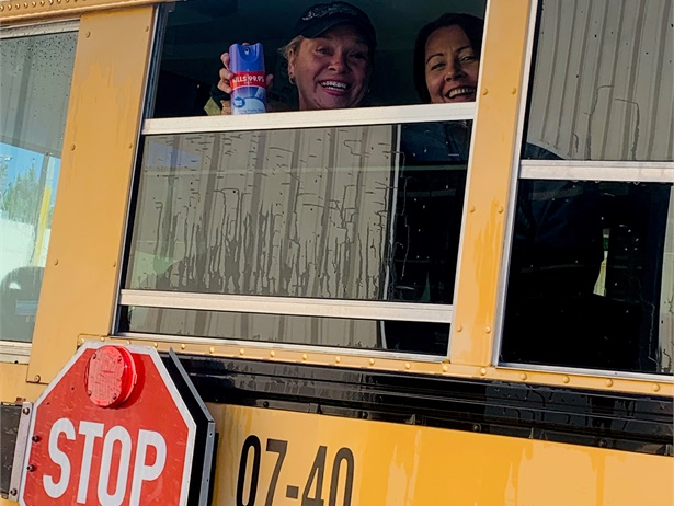 Baldwin County (Ala.) Schools drivers clean the bus of a fellow driver who isn't able to leave home due to being at high risk for contracting COVID-19. (The drivers were practicing social distancing before and after the photo was quickly taken.) Photo courtesy Tony Pollard