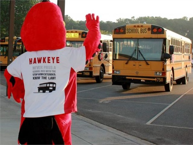 Cobb County's stop-arm safety mascot, Hawkeye, salutes school bus drivers for National School Bus Safety Week.