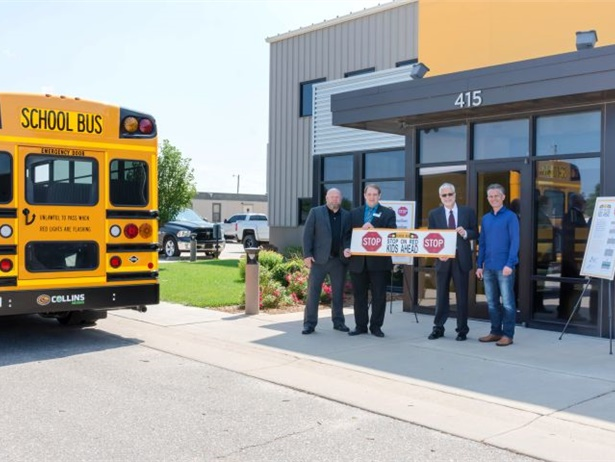 """The Kansas State Department of Education's """"Stop on Red, Kids Ahead"""" campaign includes bumper stickers donated by Collins Bus Corp. Photo courtesy Collins Bus Corp."""