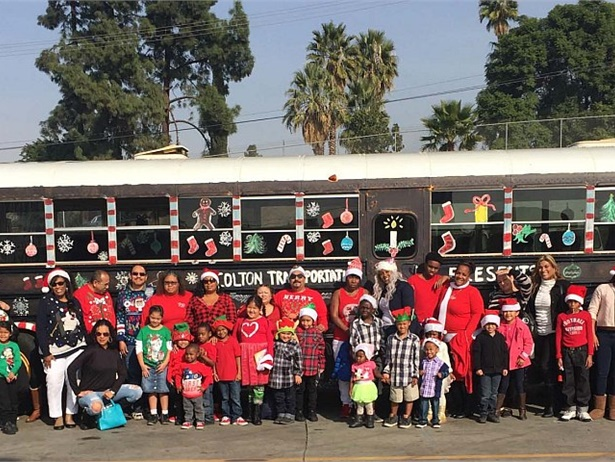 The transportation team for Colton (Calif.) Joint Unified School District collected 186 jackets, 100 toys as part of its holiday Stuff the Bus project. Photo by Erick Richardson