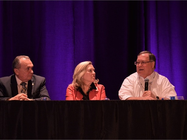 Mike LaRocco (right), president of NASDPTS, Becky Weber (center), a representative from the NSTA, and John Whetsel, a representative from the NSA, discussed several illegal passing prevention efforts during an NAPT conference town hall meetingon Monday.