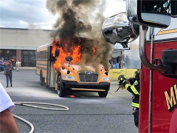 A Delaware bus driver noticed smoke coming from the engine compartment of the bus while unloading students and evacuated them. No one was on the bus when it caught fire. Photo courtesy Jack Kessel from the Dagsboro Volunteer Fire Co.