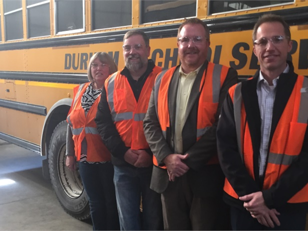 Harrisonville Mayor Brian Hasek (middle left) and Assistant Superintendent Jason Eggers (middle right) toured Durham's local transportation facility. They were joined by General Manager Wanda Davis (far left) and Region Manager Kevin Rhine (far right).