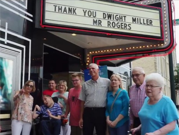 "Dwight Miller, center, of Wisconsin was nominated for a ""Be My Neighbor"" contest by his neighbor. He was honored at a movie screening. Video screen shot from the ""Won't You Be My Neighbor?"" Twitter page"
