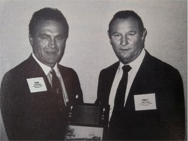 Ernest Farmer (right), Tennessee's longtime state director of pupil transportation, is seen here receiving SBF's Administrator of the Year award in 1991 from then-Publisher Frank Di Giacomo.