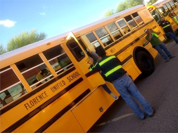 """One step Florence (Ariz.) Unified School District #1 follows for successful retention is providing training and tools for success. Shown here, bus drivers participate in a """"If you see something, say something""""-themed drill and scavenger hunt."""