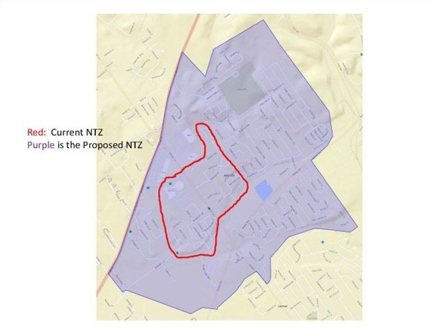 "This map shows the previous ""no transportation zone"" (NTZ) for Jeffersonville High School outlined in red, with a larger area shaded in purple illustrating the new NTZ."