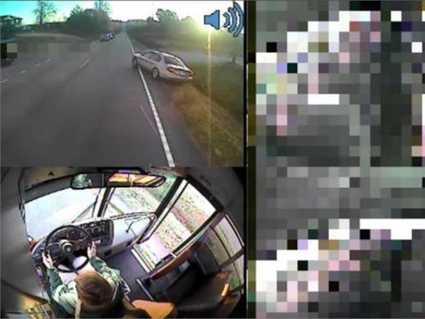 Greenville County (S.C.) Schools shared footage of a bus driver keeping students out of the path of a car as it sped along the right side of the bus. Screenshot from Greenville County Schools video