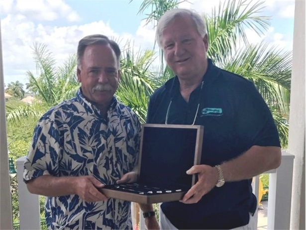 As a fitting retirement gift, maintenance veteran Gregg Peterson (left) got a collector's edition of gold-plated wrenches. At right is Doug Gallagher, Student Transportation Inc.'s senior VP of fleet and maintenance.
