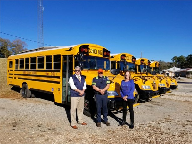The Harris County (Ga.) School District has received and put into operation four new Blue Bird buses specifically equipped to transport its special-needs students. Shown from left: Dr. Justin Finney, assistant superintendent of business services and technology; Tim Malaby, fleet manager; and Cheryl Johnson, director of transportation Photo courtesy Harris County School District