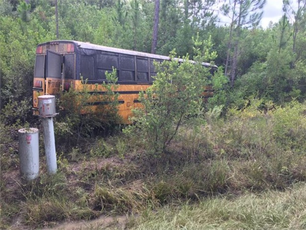 After a man allegedly stole this school bus and drove toward a city, deputies disabled the bus by shooting out a tire. Photo from Holmes County Sheriff's Office Facebook page