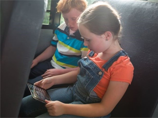 At Huntsville ISD, students can use their Chromebooks and tablets to access their textbooks and homework on the bus.