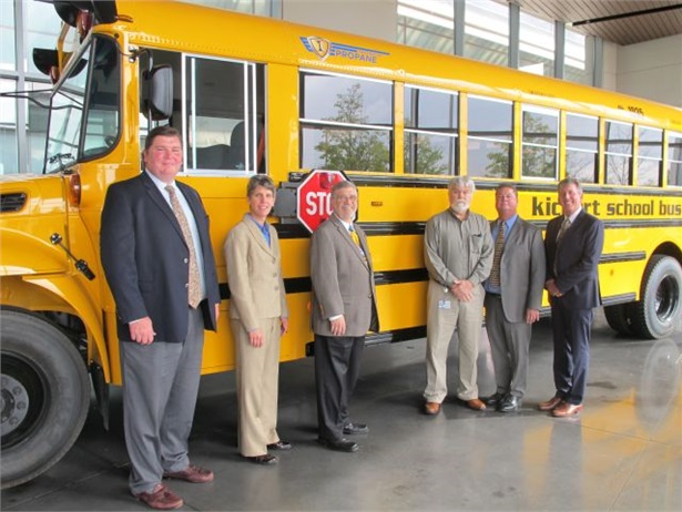 Cook-Illinois Corp. took delivery of two IC Bus CE Series propane school buses. Shown here are representatives from Midwest Transit Equipment; Cook-Illinois Corp., including John Benish Jr., president, second from right; and IC Bus, including Trish Reed, vice president and general manager.
