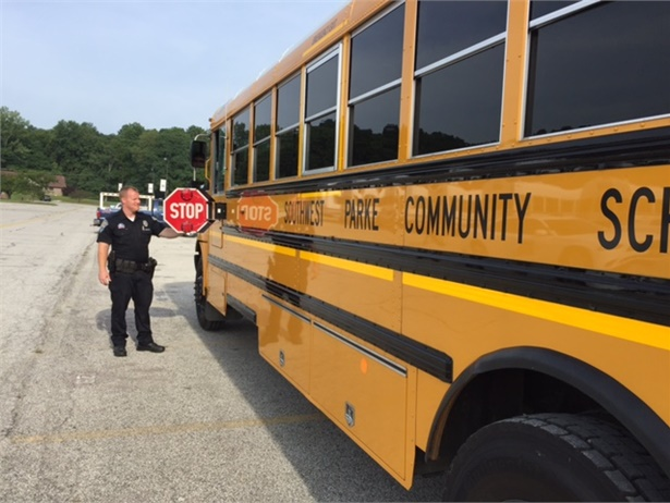 Indiana Senior Trooper Tyler Van Ness inspects a Southwest Parke Community School Corp. bus on Tuesday.