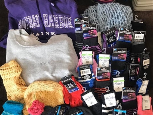 Ivy Corliss, a bus driver with Lewiston (Maine) Public Schools,is collecting hats, gloves, scarves, and other winter gear to help keep students warm during the colder months. Photo courtesy Ivy Corliss