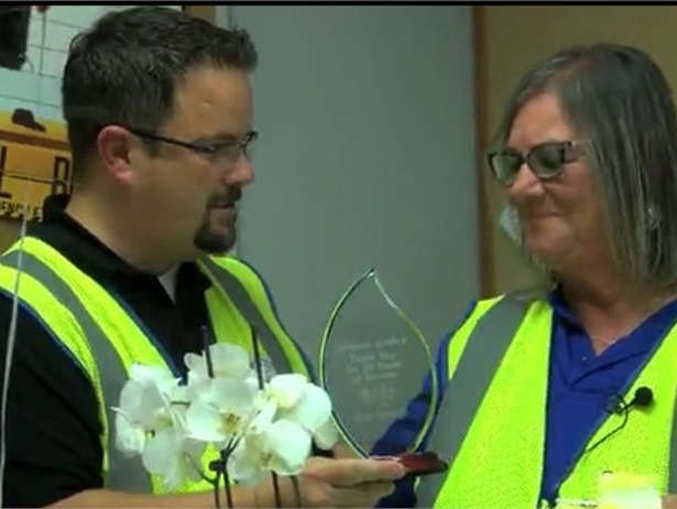 "Kansas school bus driver Sharon Lackey was named a ""Hometown Hero"" by a local news source. Shown here, she was also presented with an award for 40 years of service. Screenshot from KSNW video"