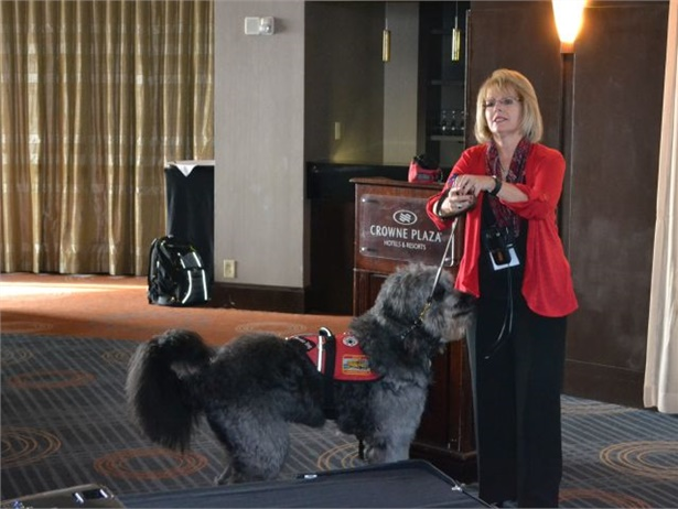 Kimberly Bish, seen here with her daughter Danielle's seizure assistance dog, Bobo, discussed her training efforts with Ohio school bus drivers.