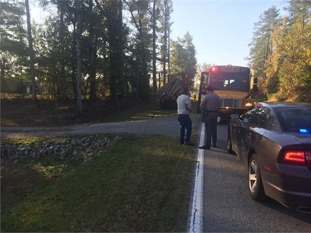 ALancaster County (S.C.) School District bus had stopped to pick upa student when a logging truck that was traveling toward the bus swerved to avoid another truck that was stopped for the bus. Photo courtesy Bryan Vaughn