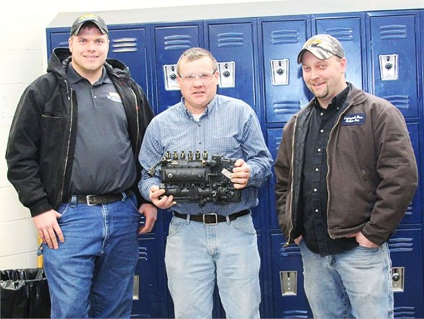 BOCES instructor Doug Pilbeam (center) holds a new injection pump donated by Leonard Bus Sales. With him are Rob Frost (left) and Mike Piatkowski of Leonard Bus Sales.