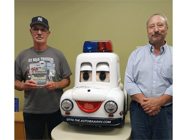 Mark Primeau (left) won AAA Hudson Valley's 2016 Safe School Bus Driver Award. He is seen here with Fred Kowalik, transportation supervisor for Berlin CSD, and AAA's Otto the Auto, which teaches children about road safety.