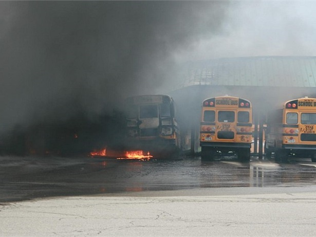 One of Dousman Transport's bus terminals and about 34 of its school buses were destroyed in a fire. Photo by Merton Community Fire Department