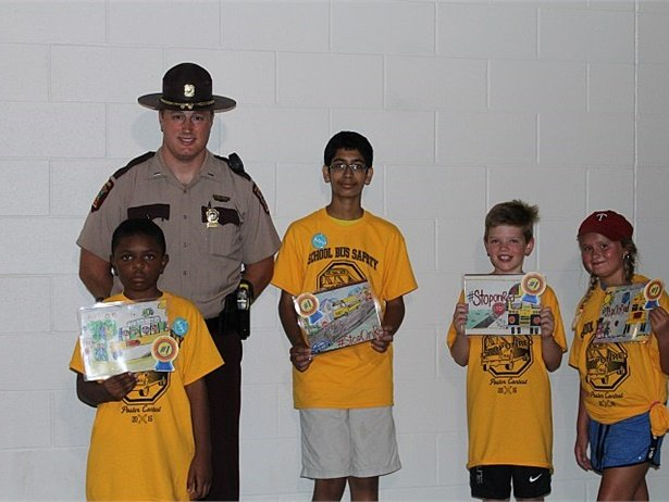 State poster contest winners were recognized at Target Field before a Minnesota Twins baseball game on Aug. 11. Pictured here is Lt. Brian Reu with the four winners whose posters were selected for the national competition.