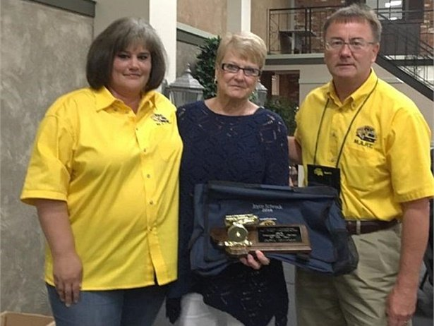 Joyce Schrock, center, won MAPT's Transportation Person of the Year. She is shown here with Donell Rosenthal, director of pupil transportation at the Office of Public Instruction at left, and MAPT President Jim Carroll.