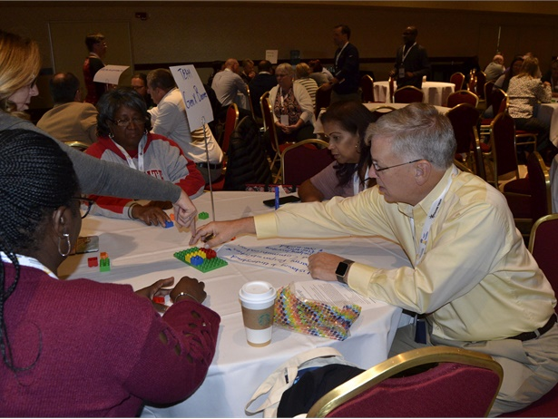 NAPT conference attendees took part in a team-building exercise that involved constructing a replica of a model with Legos.