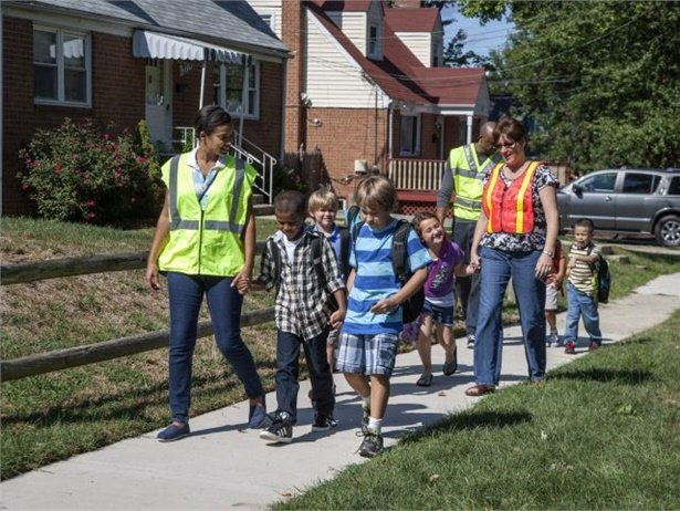 As defined by Safe Routes to School, a walking school bus is a group of children walking to school with one or more adults. File photo courtesy NHTSA