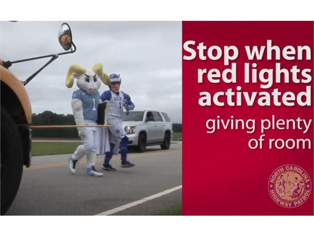 North Carolina State Highway Patrol troopers are monitoring bus routes and partnered with local universities on a school bus safety PSA. Shown here is a screenshot from that PSA.