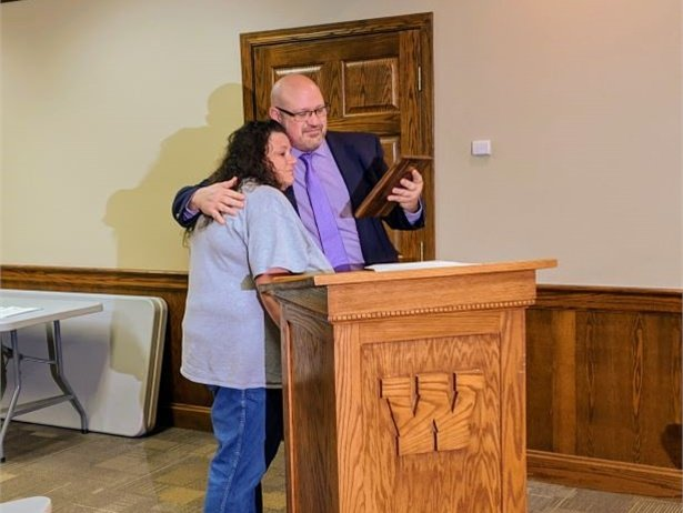Katrina Self, a bus driver for Washington Court House City Schools, was recognized with a plaque for putting her training to good use by reviving the child of a parent on her route. Photo courtesy Trevor Patton
