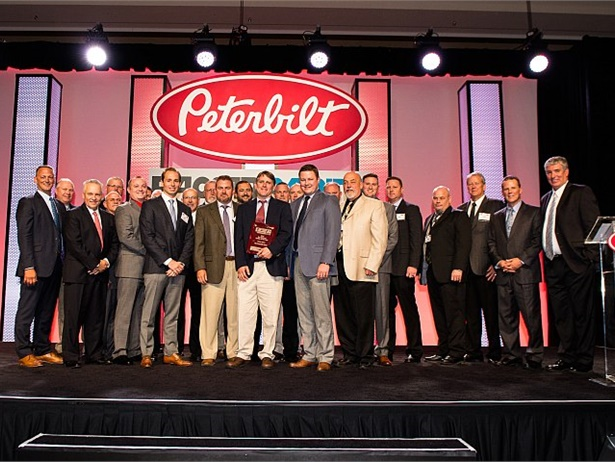 Representatives of The Peterbilt Store accept the TRP Bus Segment Dealer of the Year Award at the PACCAR Parts and Peterbilt 2016 Parts and Service Meeting in Orlando, Florida. Photo courtesy of Rosena Usmani.