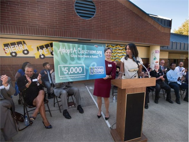Xanthi Pinkerton (middle left), Elk Grove USD's director of communications, and Joy Alafia, president/CEO of the Western Propane Gas Association, display a $5,000 check for classroom materials at a Propane Education & Research Council event at Sierra Enterprise Elementary in Sacramento, California.