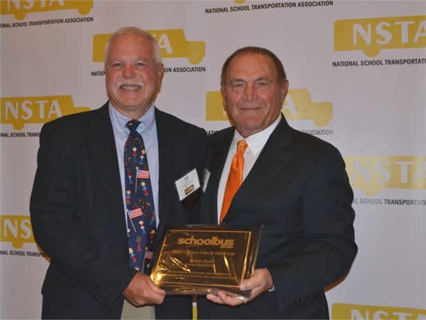 Robert Hach (left) of Sunrise Transportation receives the Contractor of the Year award from School Bus Fleet VP/Publisher Emeritus Frank Di Giacomo.