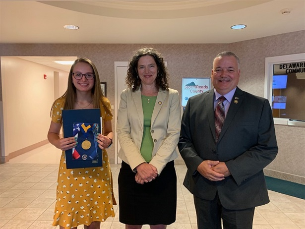 Sen. Jen Metzger (center) presented Rachel Trimbell with the New York State Senate Liberty Medal for helping save another student who was choking on a piece of candy while on the school bus. Pictured right is Delaware County Sheriff Craig DuMond. Photo courtesy of Sen. Metzger's office