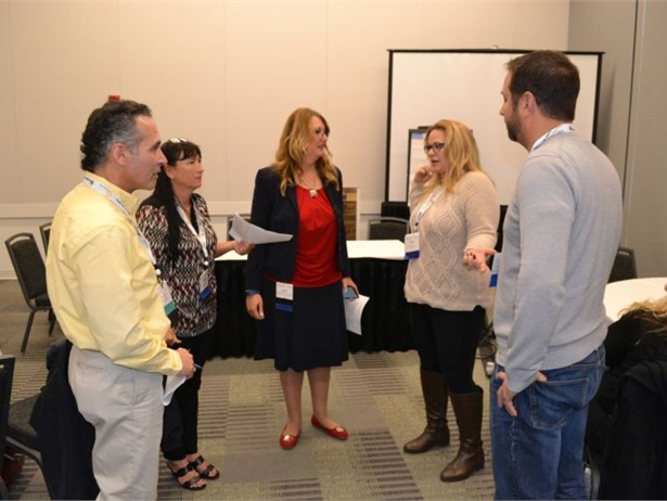 In a National Association for Pupil Transportation (NAPT) conference session, Launi Harden (center) and Alex Robinson (not pictured) led a mock IEP meeting in which participants discussed a behavioral issue with a special-needs school bus passenger.
