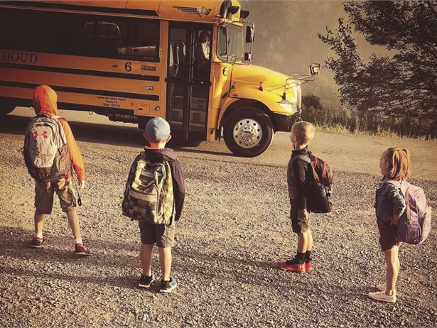Alicia Jennings, owner of Jennings Bus Co. in Canton, Penn., captured this shot of her four grandchildren getting ready to board the bus for their first day of school. She said their excitement about school buses and their family bus business has been brewing since they were infants.