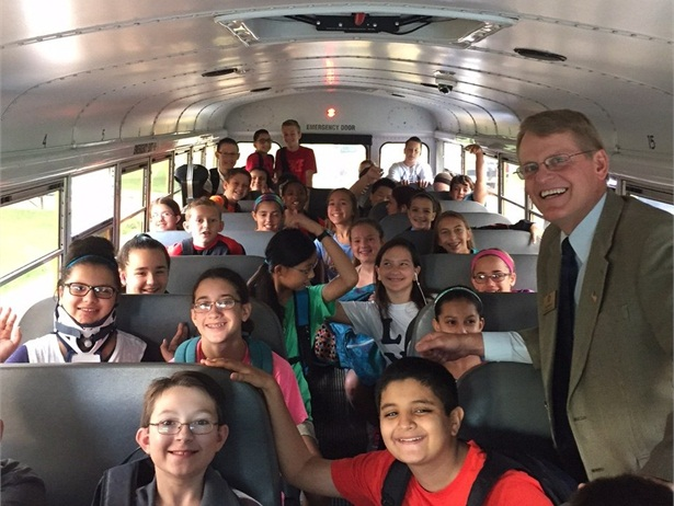 To manage student behavior, drivers need to be firm and fair, but not overly strict, says Will Rosa, director of transportation at Parkway School District in Chesterfield, Missouri. Shown here are students from Parkway West Middle School with Superintendent Dr. Keith Marty.