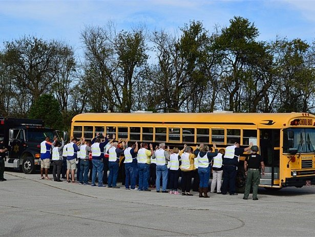 The National Association for Pupil Transportation held an interactive security exercise at its annual Summit in November. Here, attendees participate in a hostage situation exercise with local law enforcement.